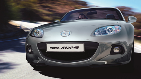 Mazda MX-5 driving on road