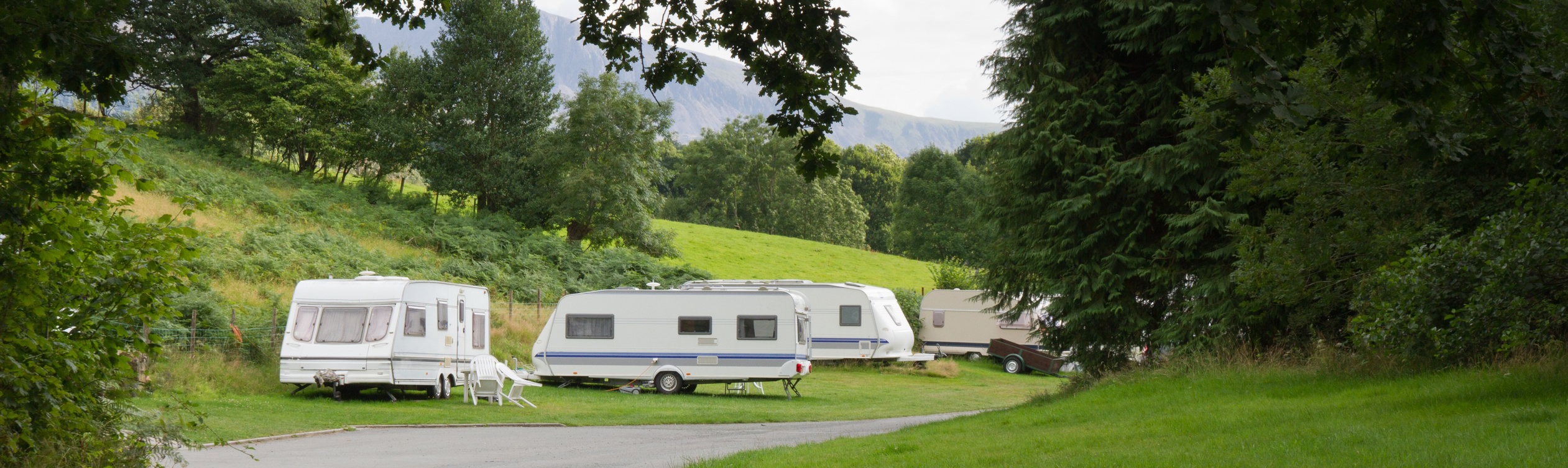a row of caravans in the countryside