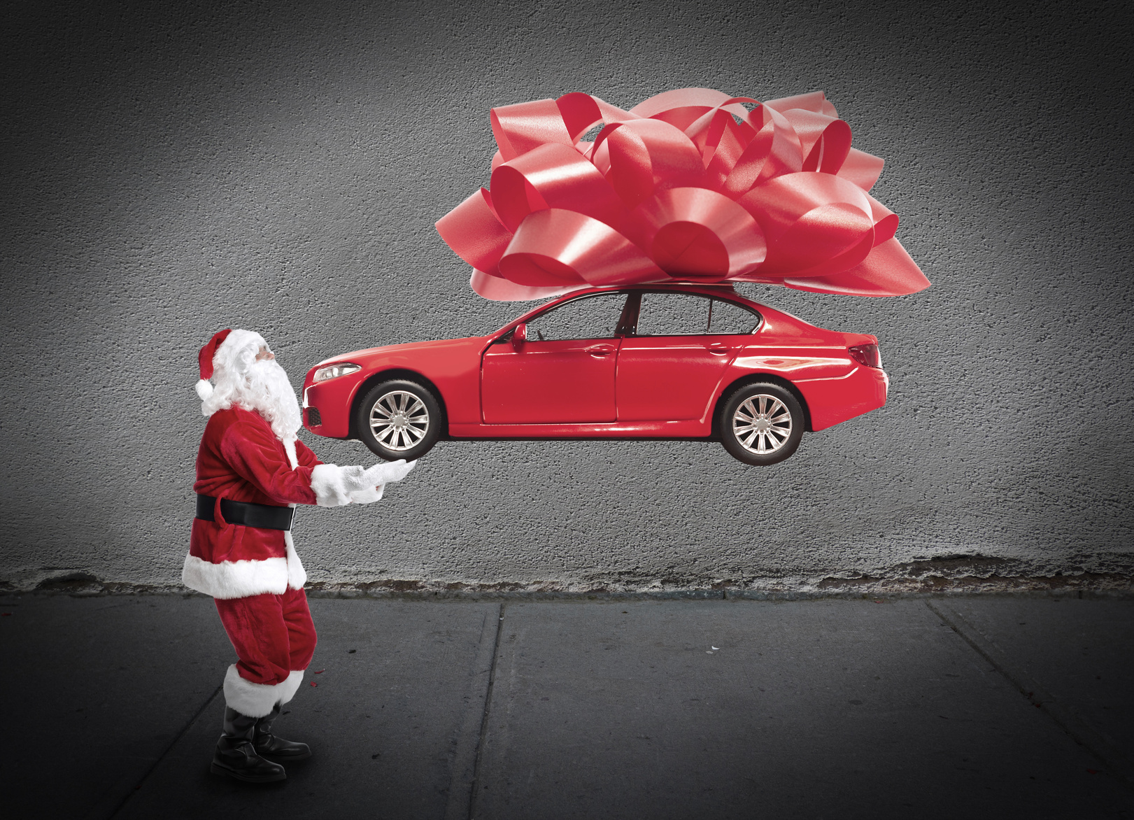Santa delivering a car