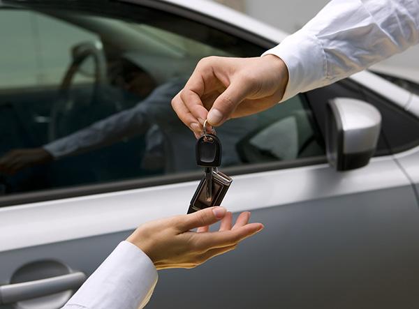 Handing over keys to new car