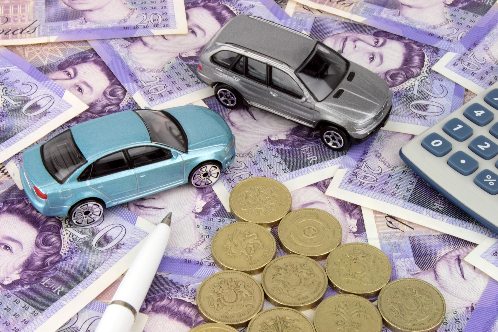 toy cars on money