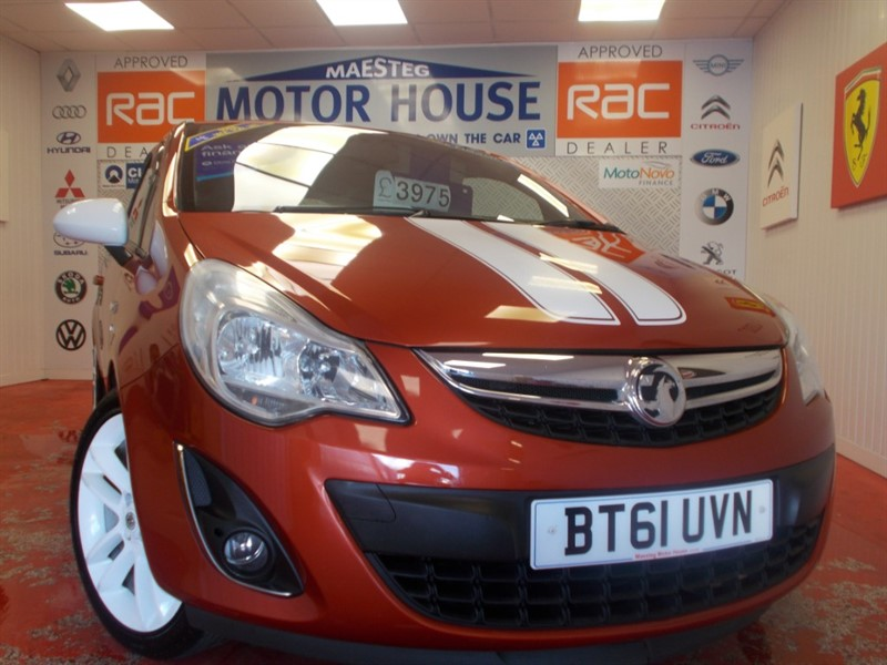 used Vauxhall Corsa SXI AC(ONLY 62000 MILES IN STUNNING ORANGE) FREE MOT'S AS LONG AS YOU OWN THE CAR!!! in glamorgan